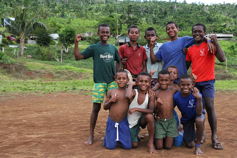 Maniava's young men on their makeshift sports field.