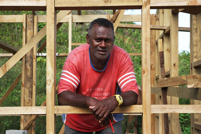 That's Vilikesa Balecala, who's the foreman overseeing the dormitory project. He's also a Suva church pastor.