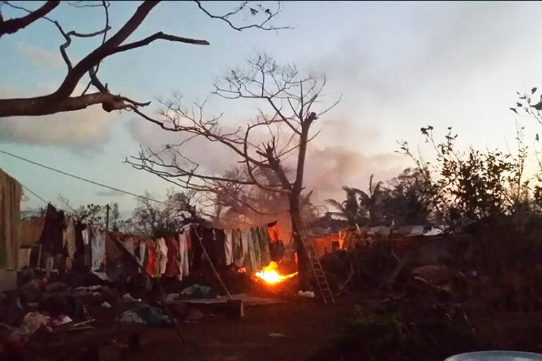 Twilight burning of the rubbish strewn about by Cyclone Pam.
