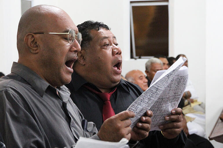 Giving it heaps: Fine Tukuafu and Paula Moa from one of the Sunday evening church choirs.