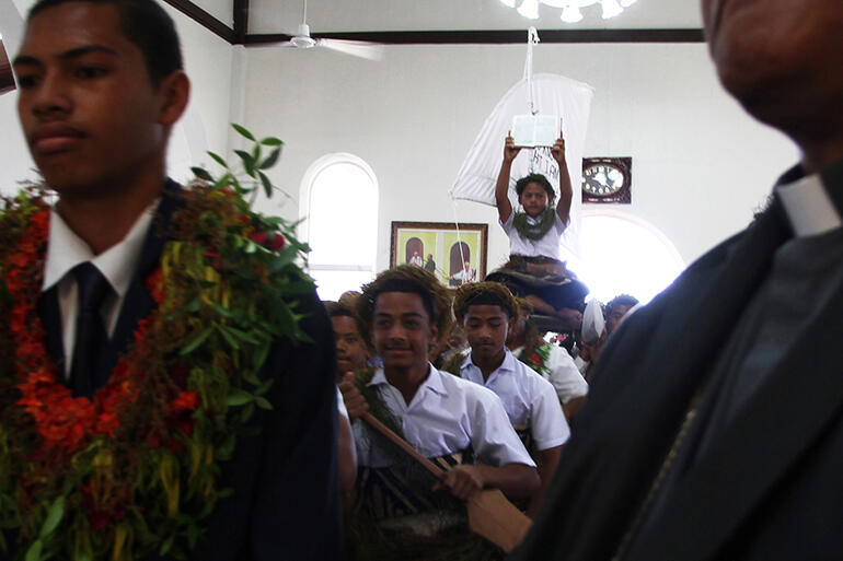Gospel held high, the sailors - all boys from St Andrew's College - process into the church. That's Kolini Hiko in the front.