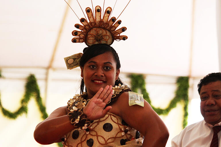 That's Latai Ofa from St Barnabas performing the Ta'olunga before the Tongan Queen Mother at the Saturday feast.