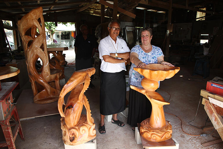 The Rev Sue Halapua standing behind the new baptismal font at the workshop where the altar furniture was sanded and varnished.