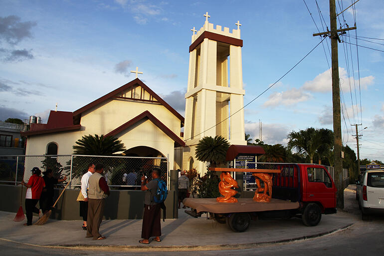 The truck bearing the new altar pulled up outside the church on Friday evening.