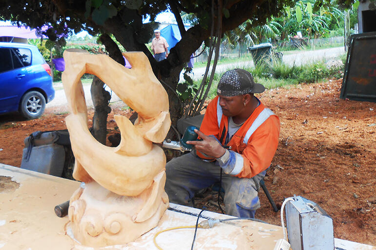 Timote Maamaloa at work, al fresco, on one of the new altar stands. Photo courtesy of Sue Halapua.