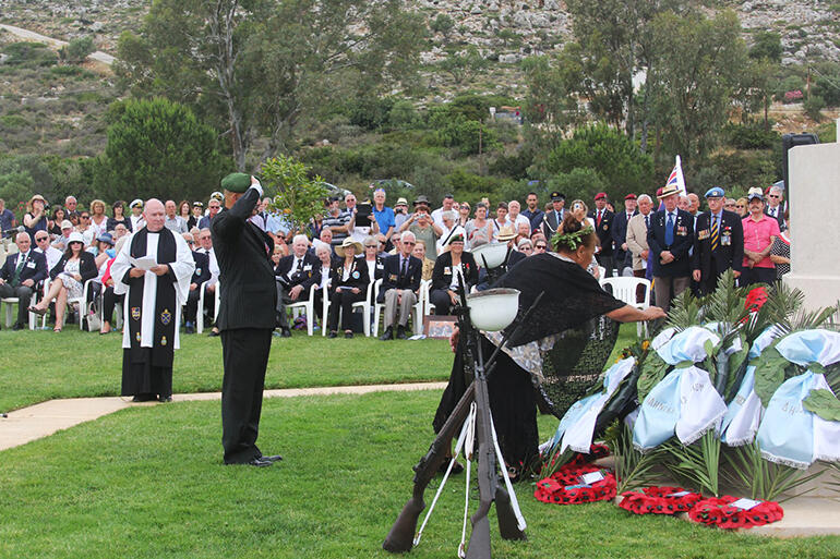 Souda Bay War Cemetery: Colenso salutes while May lays a wreath in honour of the men from the 28 Maori Battalion who died in Crete.