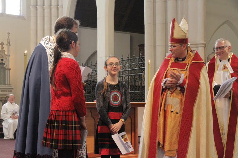 Two highs in the week after St Paul's Cathedral fire: Bishop Steven welcomes Ziva Curtis for her confirmation in St Joseph's Cathedral, Dunedin.