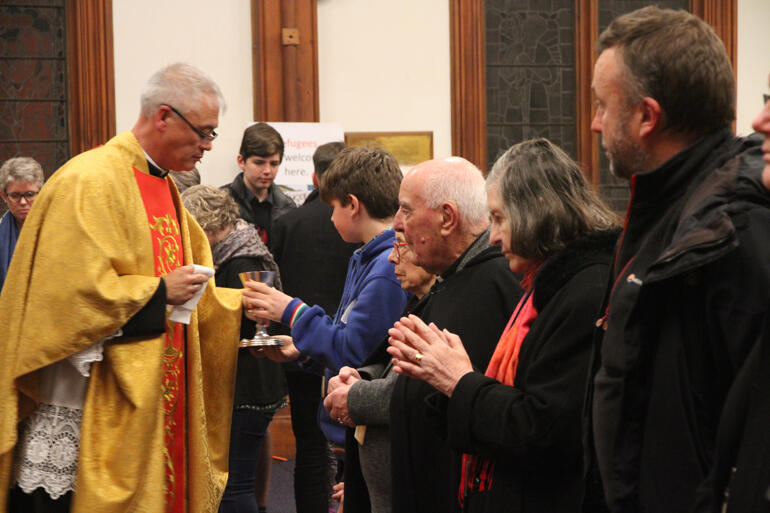 Hui members recieve the Eucharist from Fr Stephen King at St Peter's on Willis.