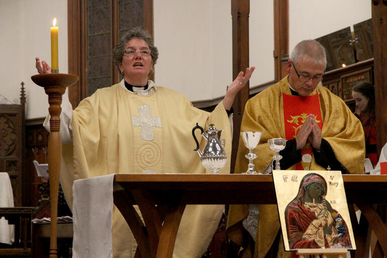 'Lift your hearts up to the Lord!' Archdeacon Wendy Scott celebrates the opening mass.