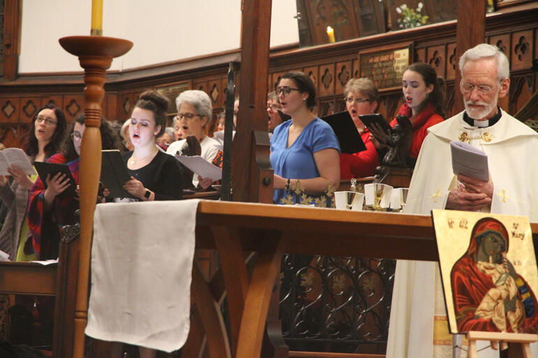 The choir gives it their all during the Hui opening mass.