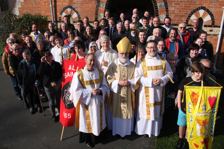Two bishops down, remaining hui members grab a group shot after the closing mass.
