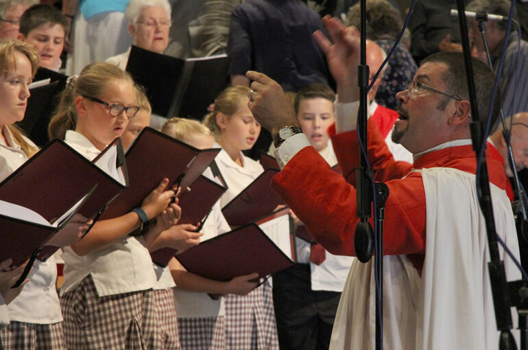 Dr John Linker directs the combined parishes and Anglican schools' choir.