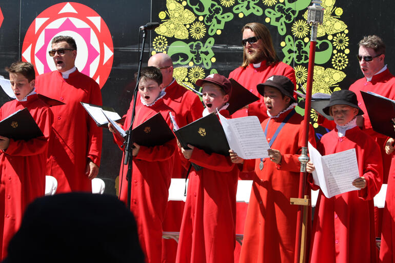 The Christ Church cathedral choir sings during Bishop Peter's installation service.