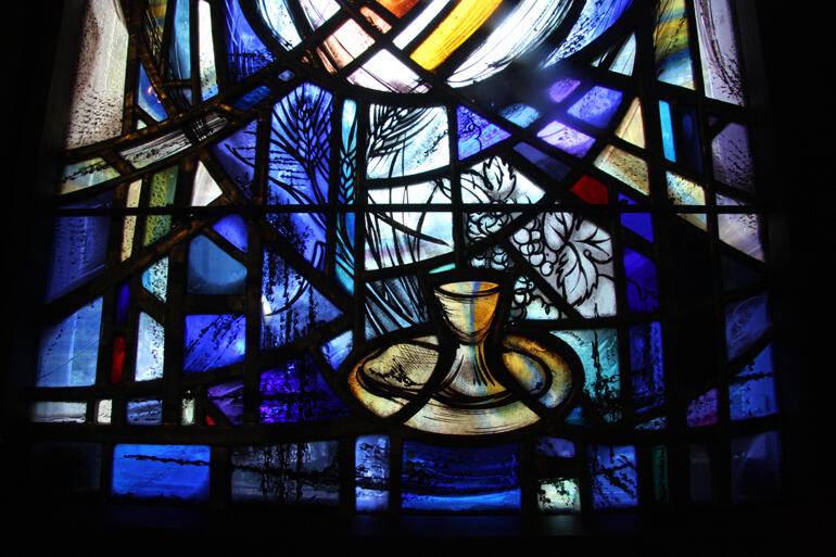 An upcoming Symposium will consider the role of spirituality in mental health. Photo: Beverley Shore Bennett window detail, Wellington Cathedral.