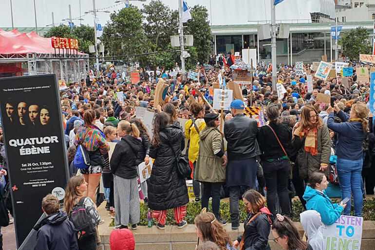 Anglicans take up their places in the Auckland throng of climate strikers.