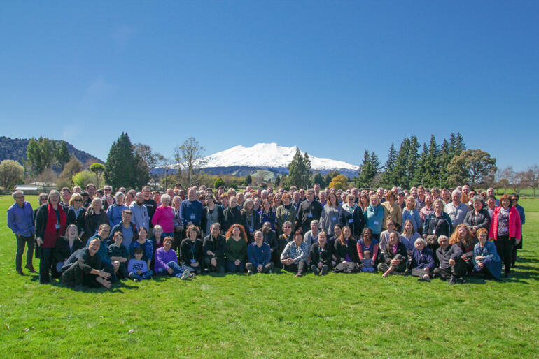 The Diocese of Wellington 2019 Synod lines up in sight of Mount Ruapehu's snow-covered slopes.