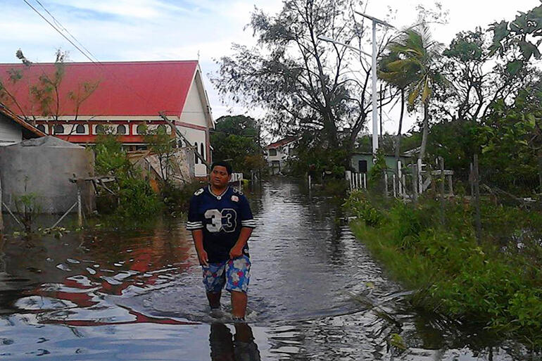 Wading down the footpath past All Saint's Fasi. Pic by Malu Elone.