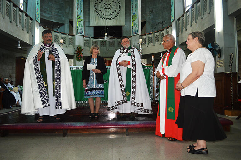 Archbishop Don Tamihere speaks to Rev Sue Halapua, at right. That's Belinda Holmes between the two archbishops.