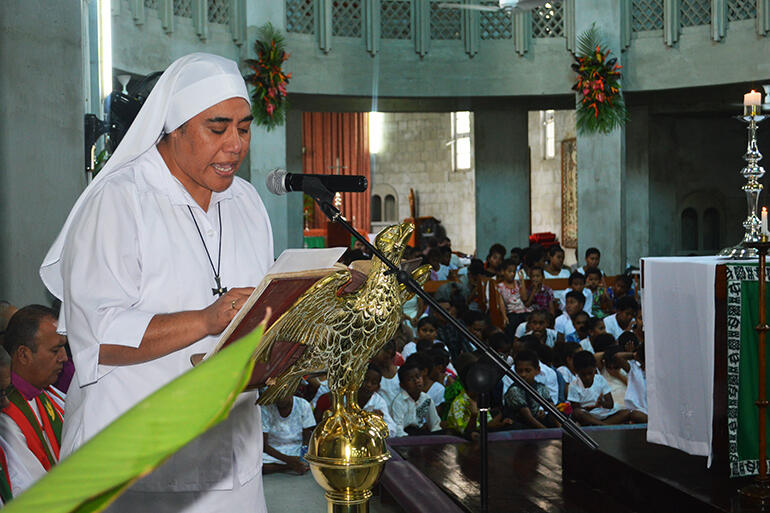 Sr Kalo, from St Christopher's Home, Naulu, reads the gospel.