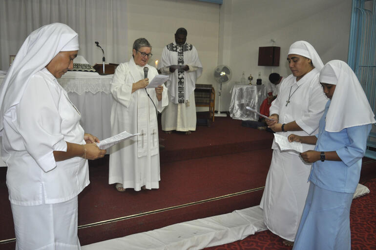 Postulant Miliva makes her vows before Moana Community of St Clare chaplain Rev Sue Halapua.