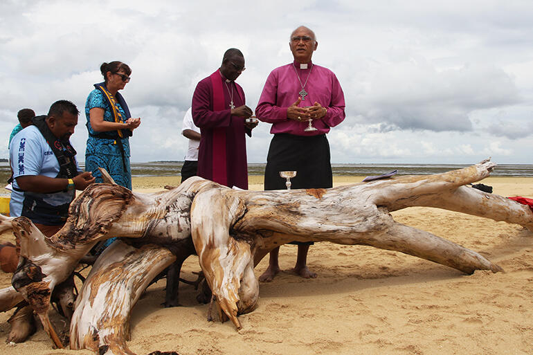 Archbishop Winston Halapua at the sandbank Eucharist - with Archbishop Josiah Idowu-Fearon behind him.