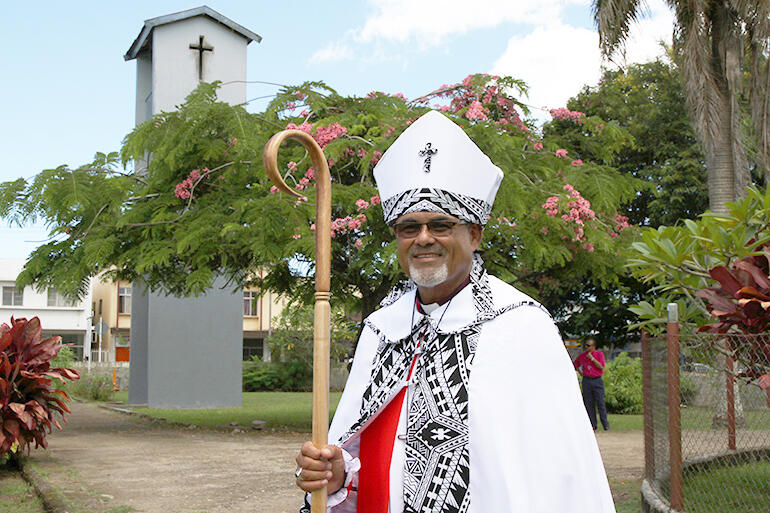 Bishop Henry in the grounds of St Thomas' Labasa - which is beside the school playground where the service was held.